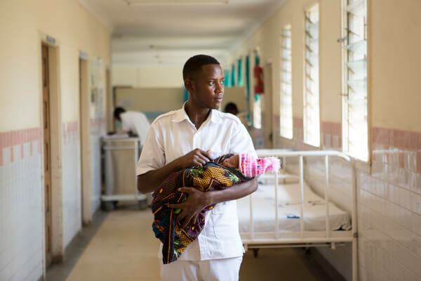 Nurse Midwife Daniel Paulo at work in his ward for women who had caesarians or who have been admitted with complications pre and post partum. Kiomboi District Hospital, Kiomboi, Tanzania.